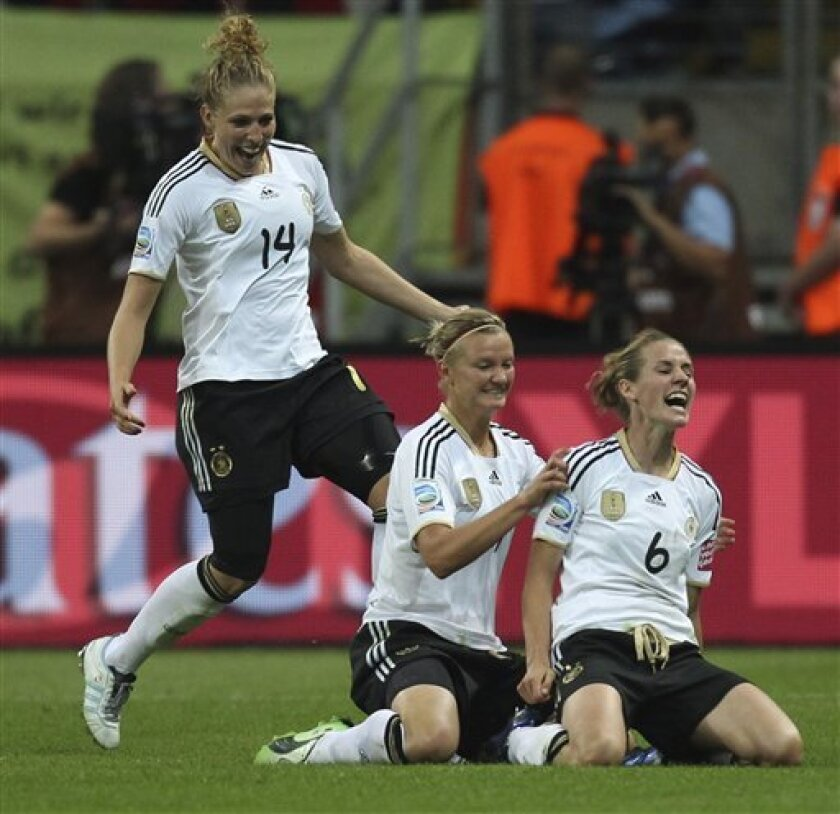 Germany's Simone Laudehr, right, is celebrated by her teammates Kim Kulig, left, and Alexandra Popp after scoring the opening goal during the group A match between Germany and Nigeria at the Women's Soccer World Cup in Frankfurt, Germany, Thursday, June 30, 2011. (AP Photo/Michael Probst)