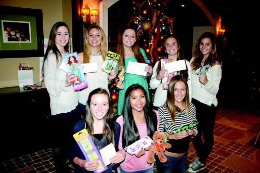 The CCHS JV cheer team donated items to fill backpacks for Make-a-Wish children at a team event at the Grand Del Mar. Carmel Valley's Olivia Scott, standing second from left, planned the charity event. Courtesy photo
