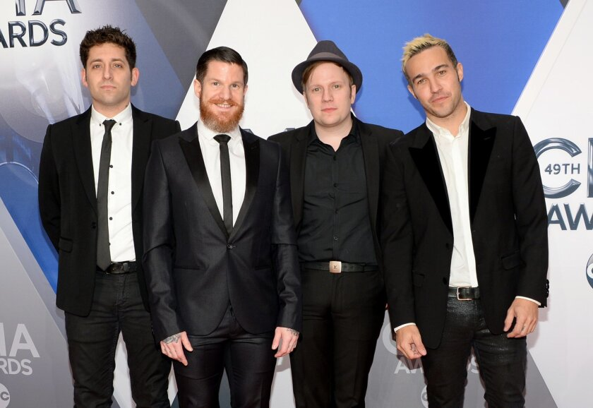 Joe Trohman, from left, Andy Hurley, Patrick Stump and Pete Wentz, of Fall Out Boy, arrive at the 49th annual CMA Awards at the Bridgestone Arena on Wednesday, Nov. 4, 2015, in Nashville, Tenn. (Photo by Evan Agostini/Invision/AP)