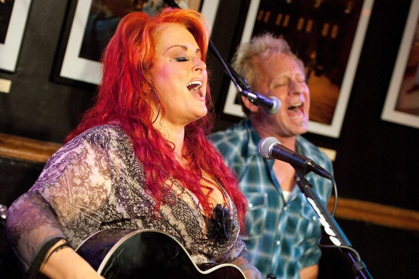 NASHVILLE, TN - JUNE 03: (EXCLUSIVE ACCESS SPECIAL RATES APPLY) (L-R) Wynonna Judd and Cactus Moser perform a special acoustic show at Bluebird Cafe on June 3, 2013 in Nashville, Tennessee. (Photo by Erika Goldring/Getty Images for MSO PR)