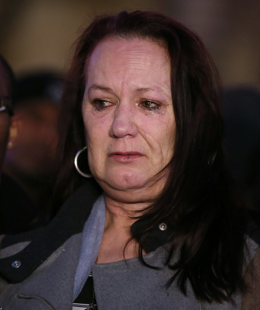 Pam Duggan, mother of Mark Duggan who was shot by police in north London in 2011, cries outside the Royal Courts of Justice following the verdict from the inquest into her son's death Wednesday, Jan. 8, 2014. Jurors at London's High Court have found by a majority of eight to two that 29-year-old Ma