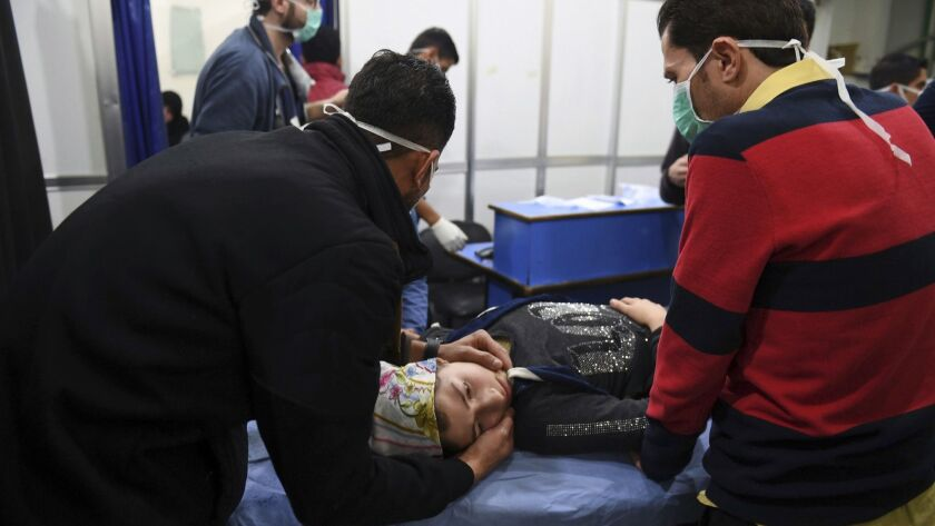 A woman receives treatment after a suspected poison gas attack on her town of Khalidiya in Syria's Aleppo province on Nov. 24, 2018.