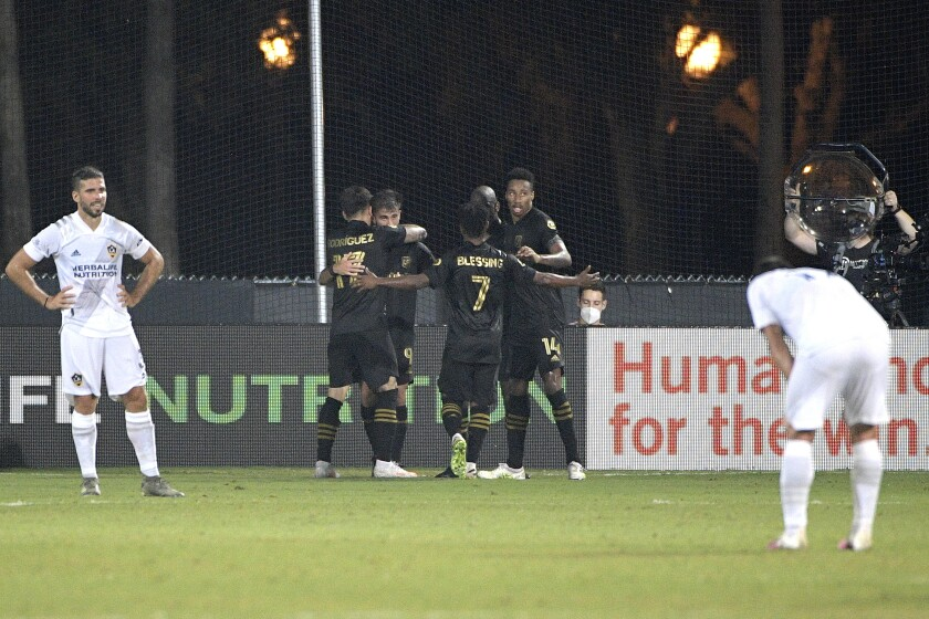 Los Angeles FC forward Diego Rossi (9) is congratulated by teammates after scoring a goal.