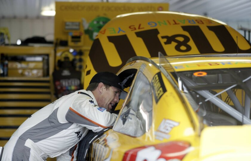 Carl Edwards, left, talks with Kyle Busch during a practice session for Sunday's NASCAR Sprint Cup Series auto race, Friday, June 3, 2016, in Long Pond, Pa. (AP Photo/Matt Slocum)