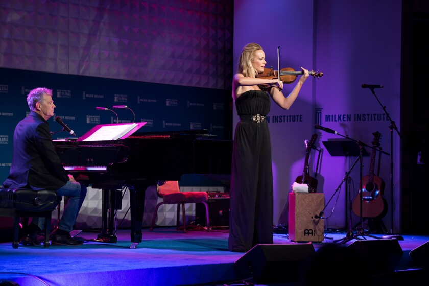 Caroline Campbell, right, performs during the Late Night session, hosted by David Foster, seated at