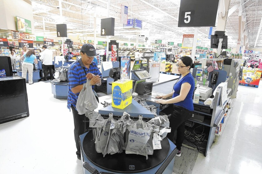 Wal-Mart said GoBank, its mobile checking account, would be available in most of its nearly 4,300 U.S. locations by late October. Above, a store in Pico Rivera.