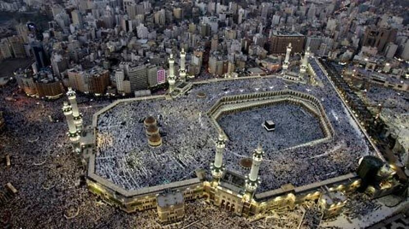 Pilgrims from all over the world fill the three levels of Mecca's Grand Mosque for prayers at sunset in the days before the hajj. The black cube-shaped building in the mosque is the Kaaba, built by the prophet Abraham.