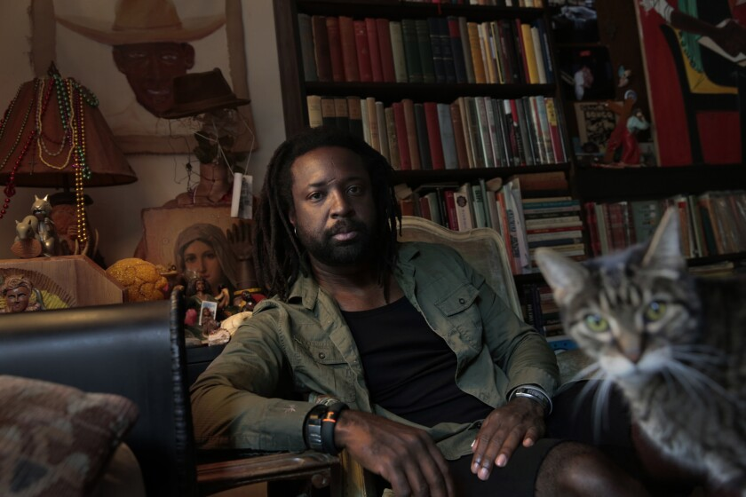"Marlon James, photographed at Jumel Terrace Books in Harlemin September, has won the Anisfield-Wolf prize in fiction for his novel ""A Brief History of Seven Killings."""
