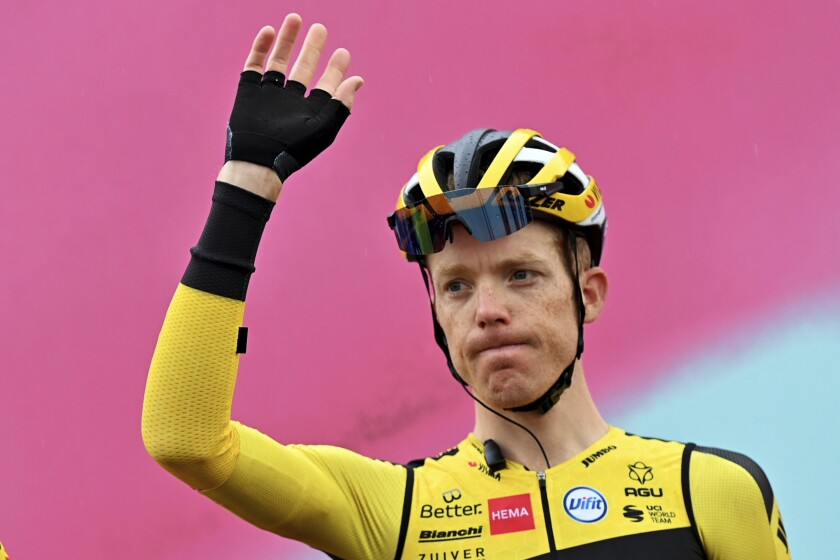 Steven Kruijswijk waves prior to the eight stage of the Giro d'Italian cycling race from San Salvo to Roccaraso, Sunday Oct. 11, 2020. All riders and team staff members were tested for COVID-19 over the last 48 hours coinciding with Monday's rest day with a total of 571 tests performed. Team Jumbo-Visma announced that Steven Kruijswijk came back positive and was withdrawn. (Gian Mattia D'Alberto/LaPresse via AP)