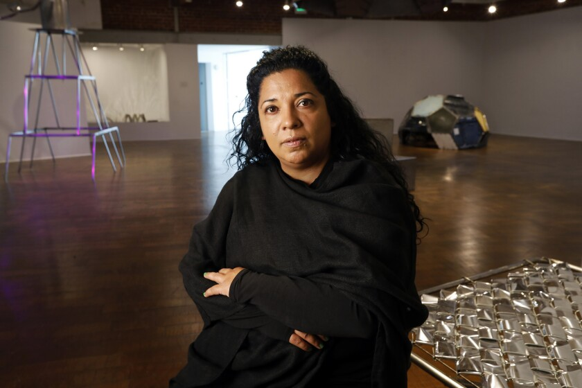 """Beatriz Cortez, the artist behind the Craft Contemporary exhibit """"Trinidad / Joy Station,"""" featuring structures that imagine a space station informed by Mayan collective living practices."""
