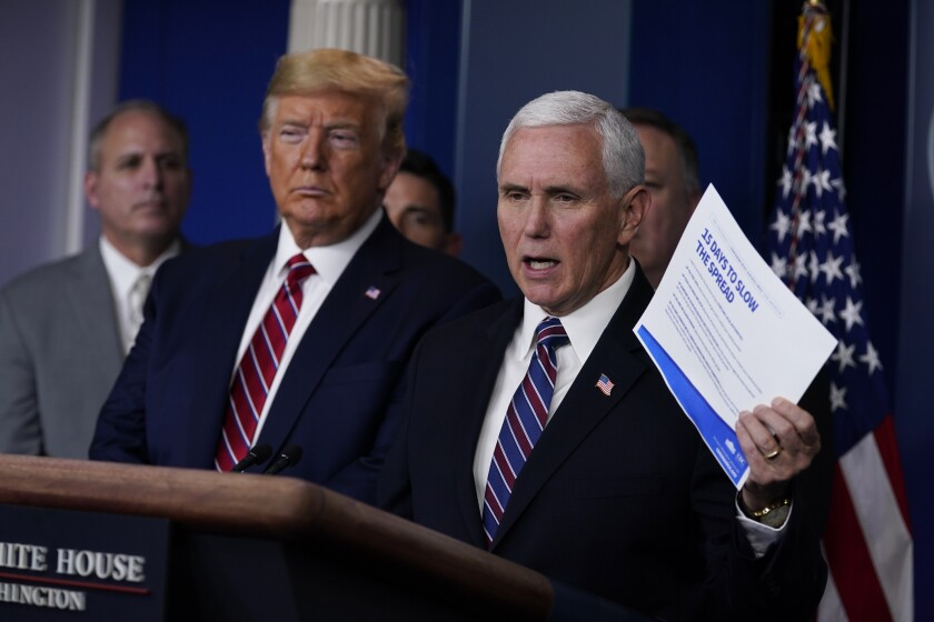 President Donald Trump listens as Vice President Mike Pence speaks at a coronavirus task force briefing in March.