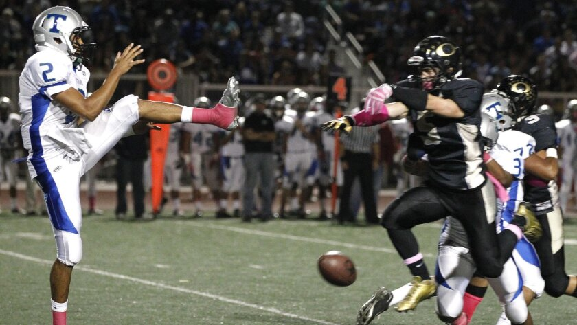Olympian's Rey Osuna blocks a punt by Eastlake's Ty Stevens, leading to a first-quarter touchdown for the Eagles.