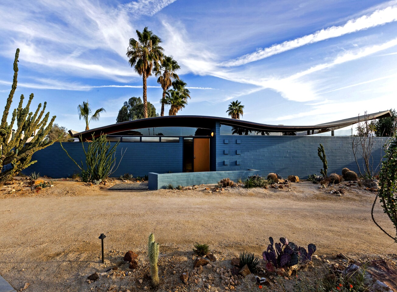 Recently restored, the 1950s gem boasts an undulating roof that resembles a wave.