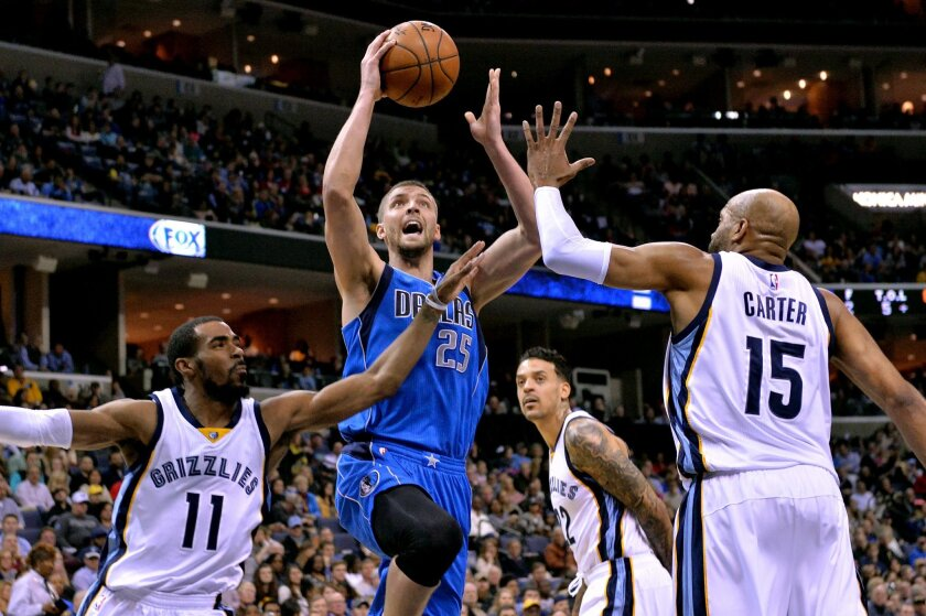 """FILE - In this Feb. 6, 2016, file photo, Dallas Mavericks forward Chandler Parsons (25) shoots between Memphis Grizzlies guards Mike Conley (11) and Vince Carter (15) in the first half of an NBA basketball game, in Memphis, Tenn. """"The state of the team? I like the team,"""" said coach RickCarlisle sai"""