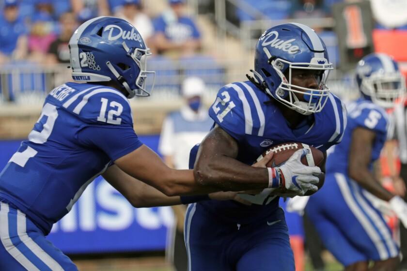 Duke quarterback Gunnar Holmberg (12) hands off to running back Mataeo Durant (21) during the first half of an NCAA college football game against Northwestern in Durham, N.C., Saturday, Sept. 18, 2021. (AP Photo/Chris Seward)