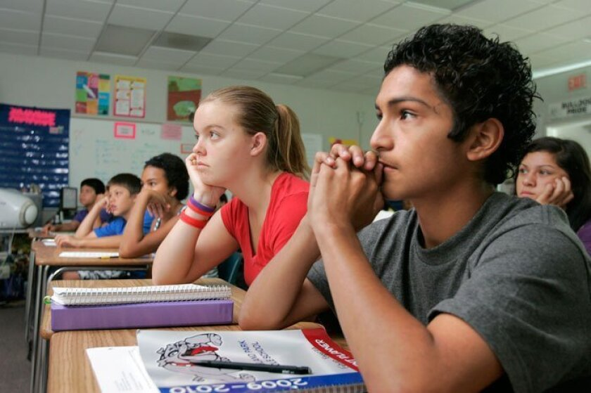 Students in teacher Amy Hrin's eighth-grade English class at Woodland Park Middle School in San Marcos listen to President Barack Obama's nationwide speech to school kids on Tuesday, Sept. 8, 2009. At right are Fabian Esparza and Jessica Nikkel. (CHARLIE NEUMAN / Union-Tribune)