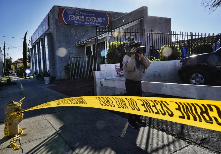 FILE - In this Wednesday, Jan. 29, 2020, file photo, crime scene tape is seen closing off an area around the grounds of the Kingdom of Jesus Christ Church in the Van Nuys section of Los Angeles. Three officials with the Philippines-based church have been charged as part of an alleged scheme to trick followers into becoming fundraisers and arrange sham marriages to keep them in the U.S. (AP Photo/Richard Vogel, File)