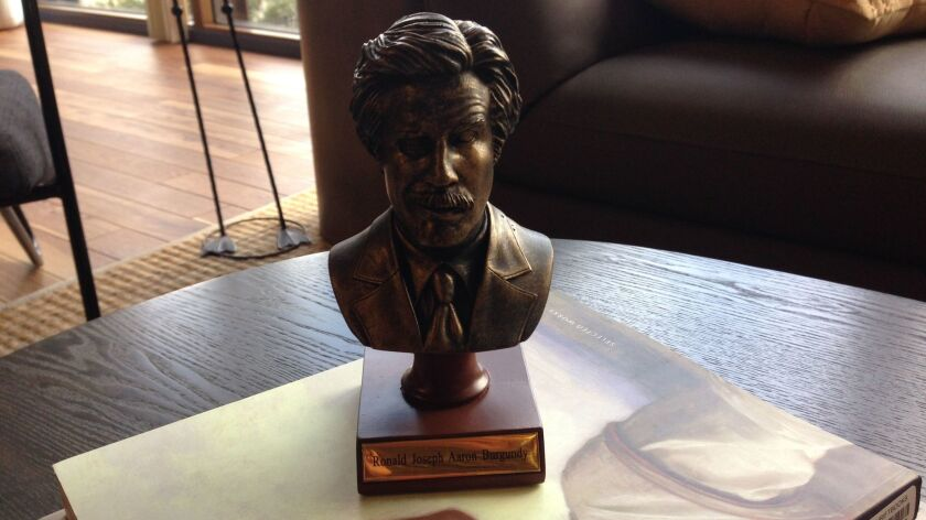A plastic bust of the fictional anchorman, Ron Burgundy, sits unpretentiously on a coffee table in the WeWork space.