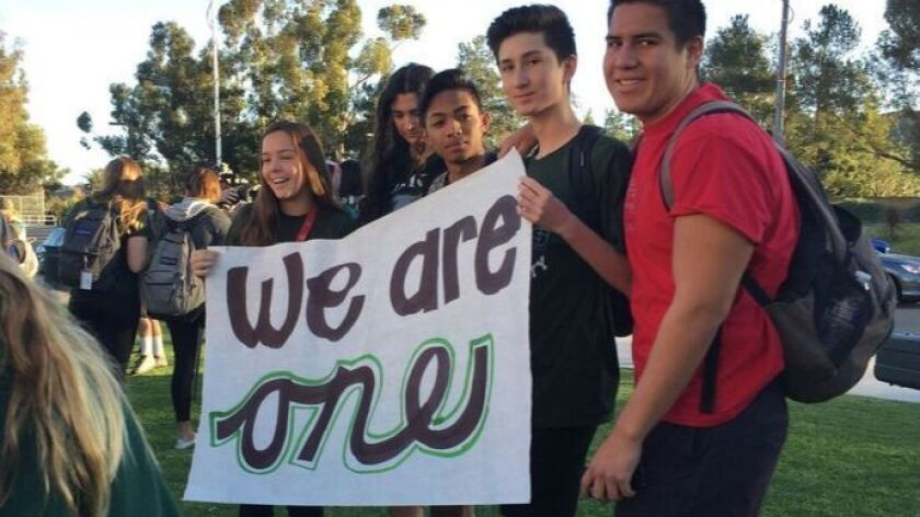 (Nov. 18, 2016) Poway High School students called for unity at a rally on Friday, after school officials reported incidents of racial, religious or political harassment following the presidential election.