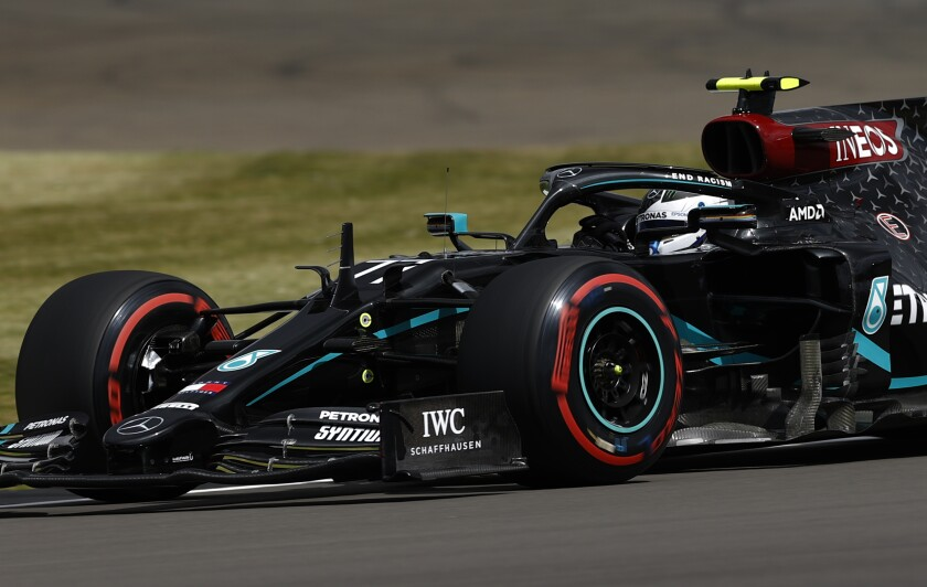 Mercedes driver Valtteri Bottas of Finland steers his car during the third free practice session for the British Formula One Grand Prix at the Silverstone racetrack, Silverstone, England, Saturday, Aug. 1, 2020. The British Formula One Grand Prix will be held on Sunday. (Andrew Boyers/Pool via AP)