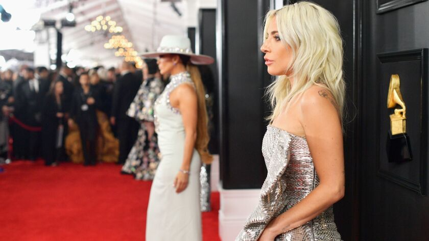 Lady Gaga with Jennifer Lopez in the background attends the 61st Grammy Awards at Staples Center in Los Angeles on Sunday. The two made our showstoppers list of best looks of the night.