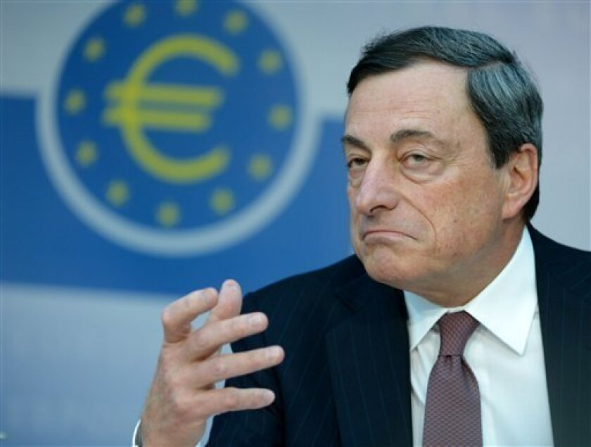 Head of the European Central Bank (ECB) Mario Draghi, speaks during a press conference in the ECB in Frankfurt, Germany Thursday April 4, 2013. The European Central Bank has left its key interest rate unchanged at a record low of 0.75 percent, holding off on further stimulus for the euro area's slack economy - despite signs that a hoped-for recovery may be delayed. (AP Photo/dpa,Arne Dedert)