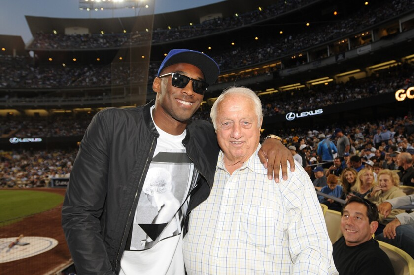 Lakers legend Kobe Bryant poses for a photo with Dodgers great Tommy Lasorda during a game at Dodger Stadium in July 2013.