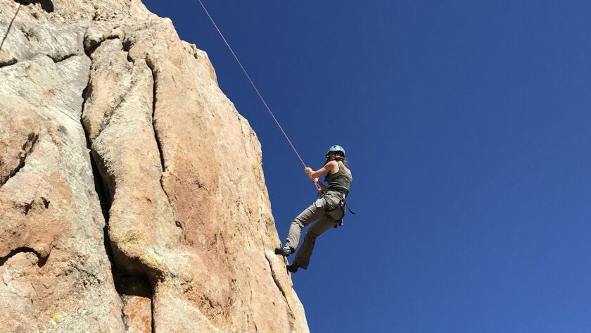 Rock climbing outside Crested Butte, one of dozens of activities included at Scarp Ridge Lodge. Cour