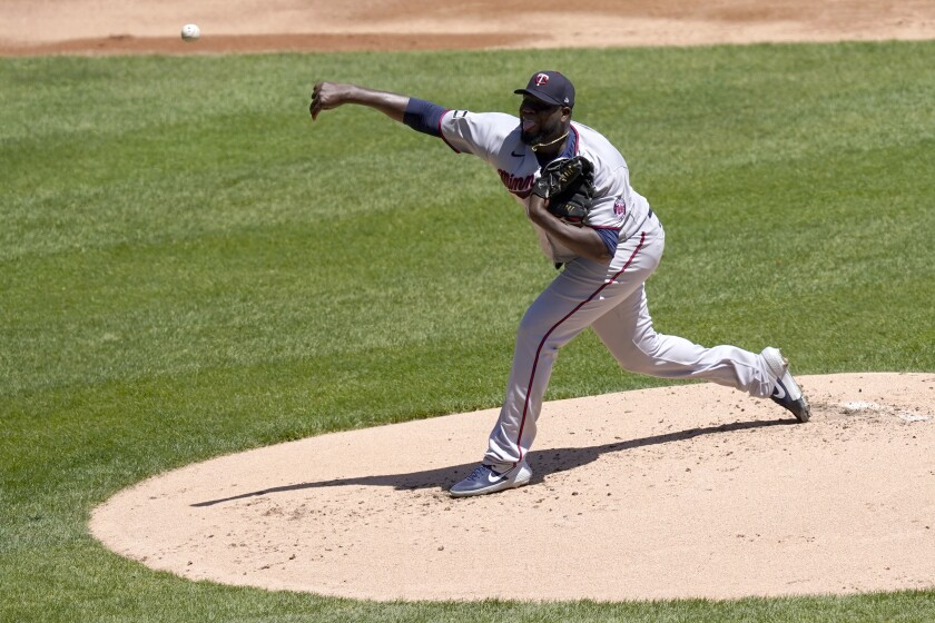 Minnesota Twins starting pitcher Michael Pineda delivers the first pitch of the first inning to Chicago White Sox' Tim Anderson during a baseball game in Chicago, Thursday, May 13, 2021. Anderson hit the first pitch for a home run. (AP Photo/Charles Rex Arbogast)