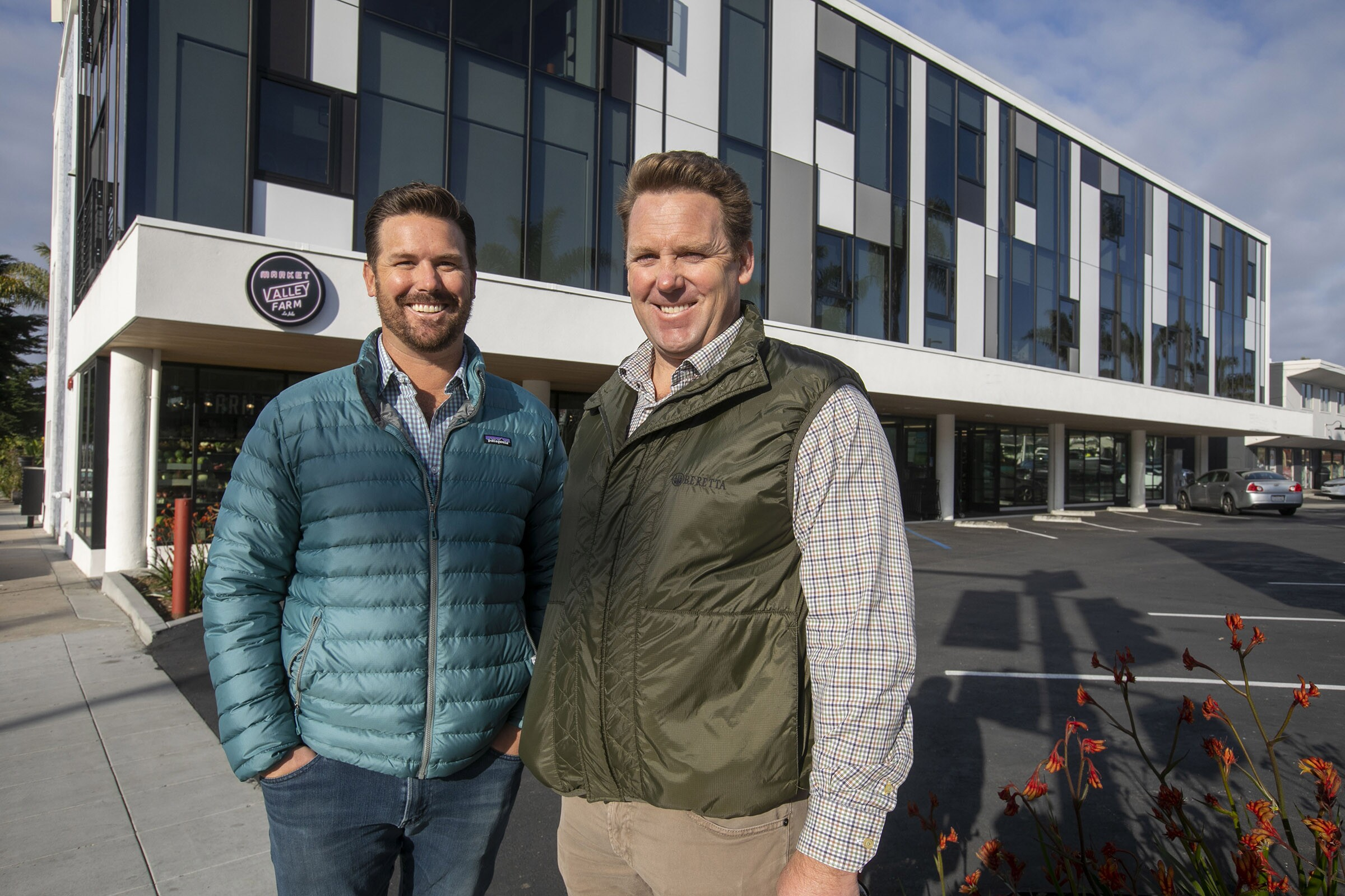 Developers Scott Murfey, right, and his brother Russ Murfey , left, outside of their recently completed Collins luxury apartment complex on La Jolla Boulevard.