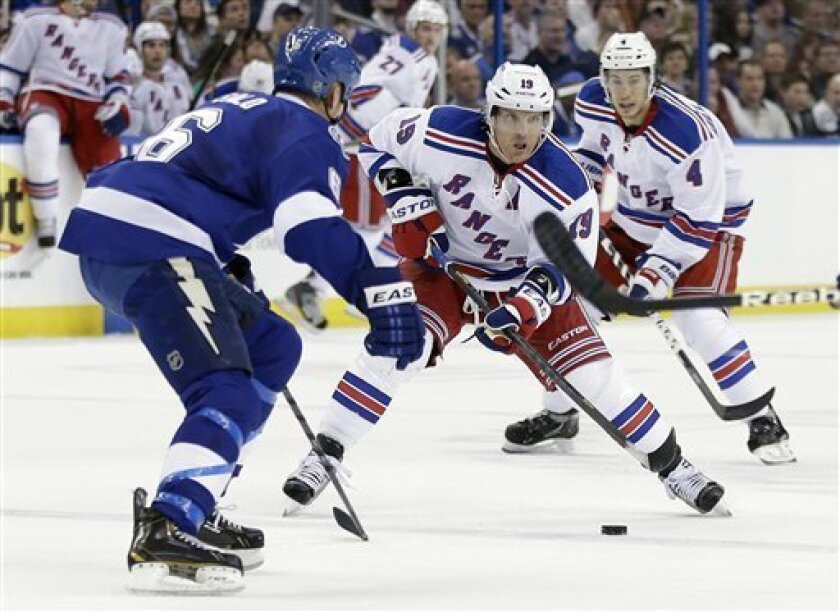 New York Rangers center Brad Richards (19) carries the puck towards Tampa Bay Lightning defenseman Sami Salo (6), of Finland, during the first period of an NHL hockey game Saturday, Feb. 2, 2013, in Tampa, Fla. Rangers' Michael Del Zotto (4) trails the play. (AP Photo/Chris O'Meara)