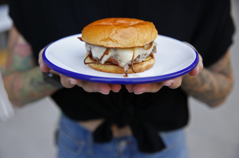 Go Get Em Tiger, L.A.'s burgeoning coffee franchise, is serving up one of the city's best cheeseburgers