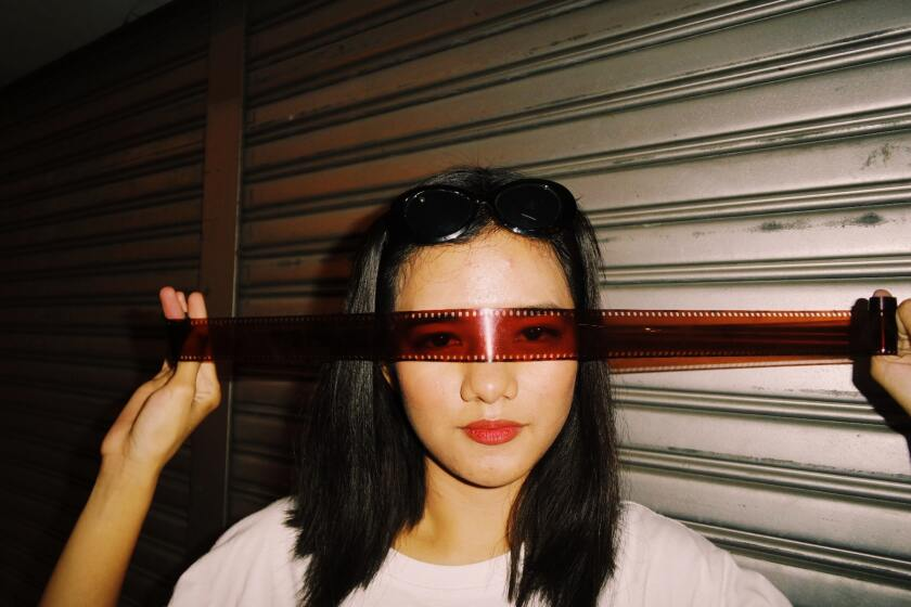 woman-wearing-camera-film-onto-eyes-3053844.jpg