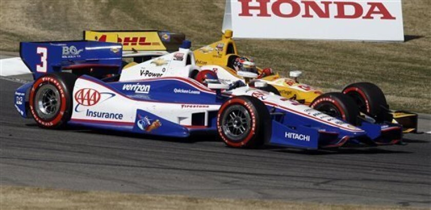 Helio Castoneves (3), of Brazil, and Ryan Hunter-Reay (1) battle for position in Turn 5 during the IndyCar Series Grand Prix of Alabama auto race in Birmingham, Ala., Sunday, April 7, 2013. (AP Photo/Butch Dill)