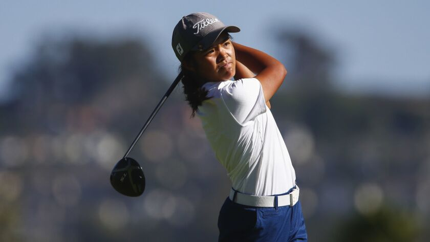 Mater Dei's Brianna Navarrosa tees off on the 10th hole of the Admiral Baker South Course.