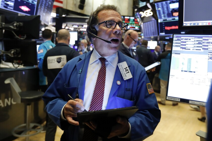 FILE - In this Oct. 30, 2019, file photo trader Sal Suarino works on the floor of the New York Stock Exchange. The U.S. stock market opens at 9:30 a.m. EST on Wednesday, Nov 6. (AP Photo/Richard Drew, File)