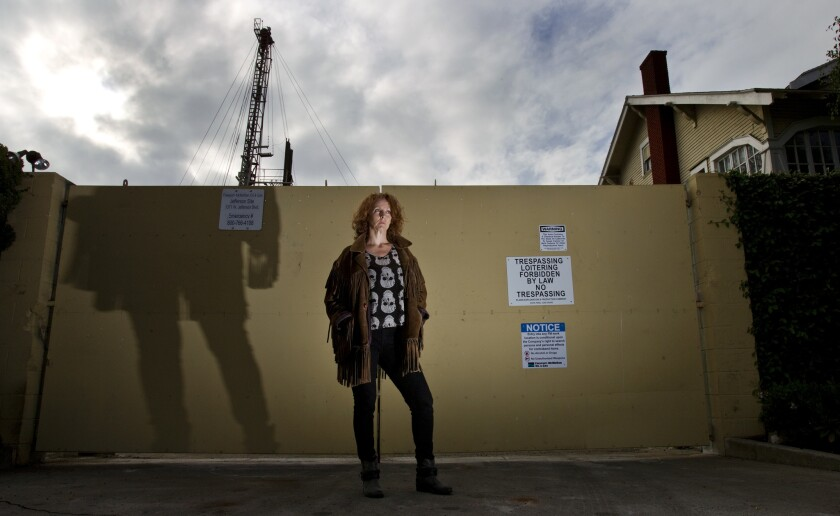 DonnaAnn Ward, founder of Cowatching Oil L.A., stands in front of a drilling site at Jefferson and Budlong Avenues on February 26, 2014 in Los Angeles, California.