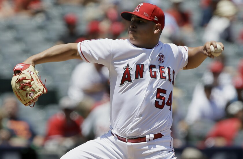 Angels starting pitcher Jose Suarez throws to a Detroit Tigers batter during the first inning on Wednesday at Angel Stadium.