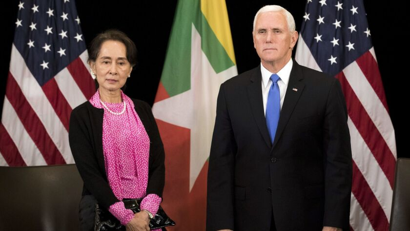 U.S. Vice President Mike Pence, right, meets Myanmar leader Aung San Suu Kyi in Singapore, on Nov. 14.