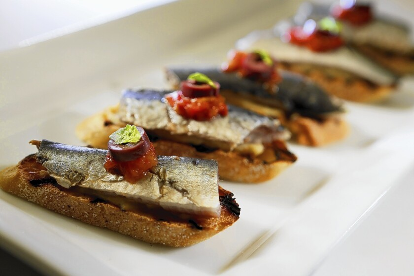 Lightly salted and pickled sardines on toasted baguette with artichoke puree, tomato and black olive.