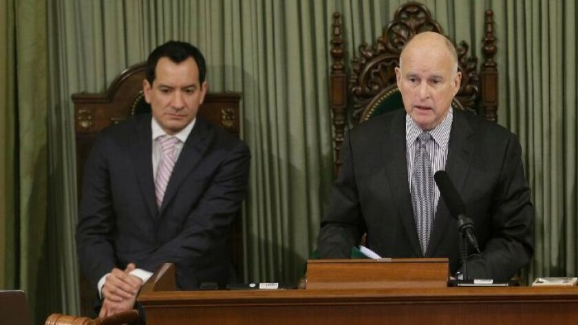 Gov. Jerry Brown, right, doesn't think much of a proposal from Assembly Speaker Anthony Rendon, D-Paramount, left, to make public colleges in California much cheaper.