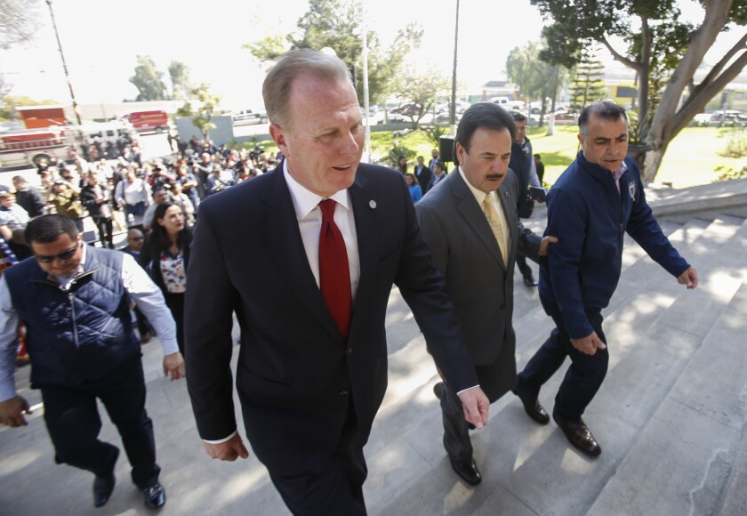 Mayors pledge to work together, on the steps of the historic Casa de la Cultura in Tijuana.