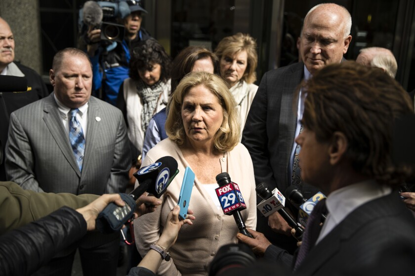FILE - In this April 30, 2018 file photo Maureen Faulkner, the widow of slain Philadelphia police officer Daniel Faulkner, speaks with members of the media after a hearing for Mumia Abu-Jamal, convicted in the 1981 murder of her husband, in Philadelphia. The city of Philadelphia is poised to revisit one of its most contentious murders as prison activist Mumia Abu-Jamal fights for another day in court in a 1981 police slaying. Maureen Faulkner fears she will never find closure in the criminal justice system after nearly 40 years. She filed a petition Thursday, Sept. 19, 2019 to get Philadelphia District Attorney Larry Krasner's office recused from the case after Krasner failed to oppose Abu-Jamal's bid for a new court hearing.(AP Photo/Matt Rourke, File)