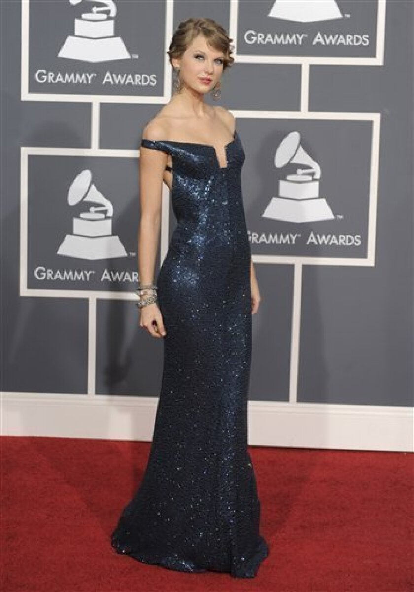 Taylor Swift arrives at the Grammy Awards on Sunday, Jan. 31, 2010, in Los Angeles. (AP Photo/Chris Pizzello)