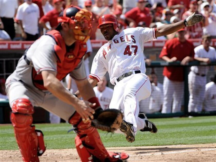 Los Angeles Angels' Howie Kendrick slides into home plate as Boston Red Sox catcher Jason Varitek waits for the ball in the seventh inning of a baseball game in Anaheim, Calif., Sunday, July 19, 2008. The Angels won 4-2. (AP Photo/Matt A. Brown)