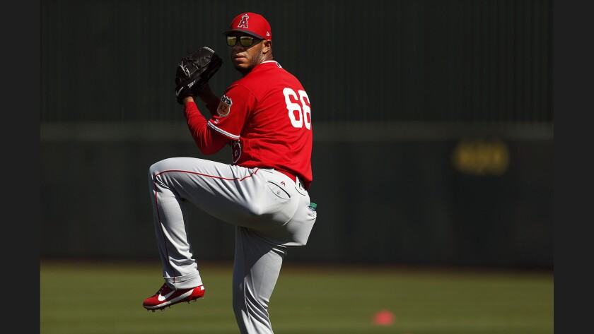 Angels relief pitcher J.C. Ramirez warms up during spring training on Feb. 24 at Tempe Diablo Stadium in Tempe, Ariz.