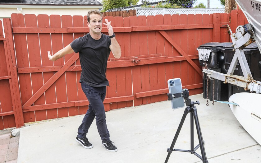 "Kevin McClintock, a teacher at The Rock Academy, practices a dance challenge before posting it to his Tik Tok feed called ""Mr. McTikTok"" on April 28, 2020 in San Diego, California. McClintock has amassed more that 80K followers and on video got 1.3 million views."