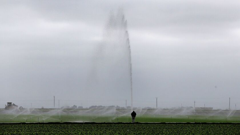 Watering crops outside Salinas