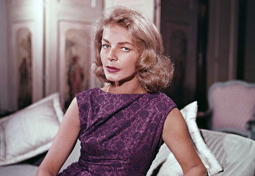 Actress Lauren Bacall had an art collection of hundreds of works. Among some of her favorite pieces were sculptures by British artist Henry Moore, with whom she maintained a correspondence. She is shown here in her home in 1965.