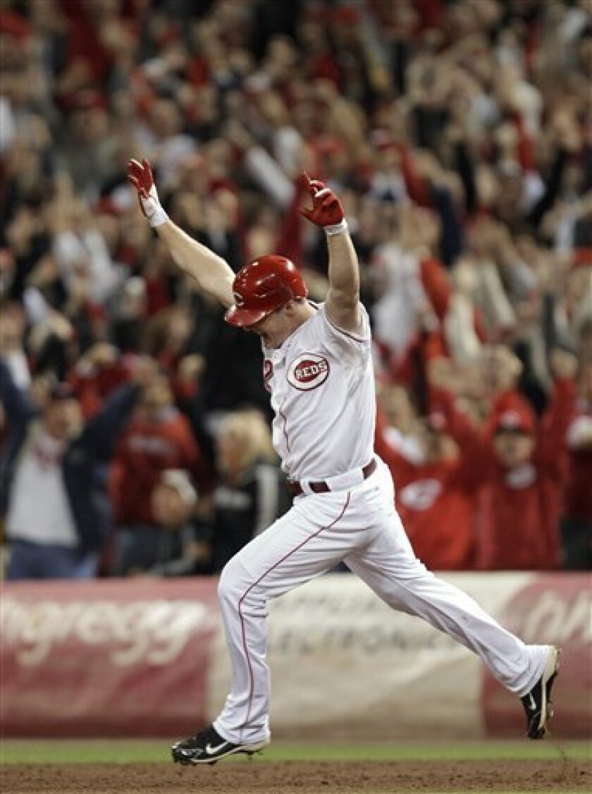 Cincinnati Reds' Jay Bruce reacts after hitting a home run off Houston Astros relief pitcher Tim Byrdak in the ninth inning of a baseball game, Tuesday, Sept. 28, 2010, in Cincinnati. Cincinnati clinched the NL Central with a 3-2 win. (AP Photo/Al Behrman)